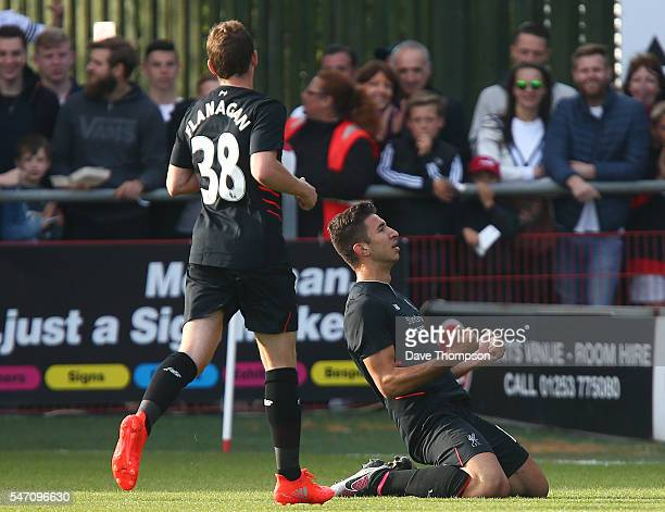 Marko Grujic of Liverpool celebrates scoring during the PreSeason Friendly match between Fleetwood Town and Liverpool at Highbury Stadium on July 13...