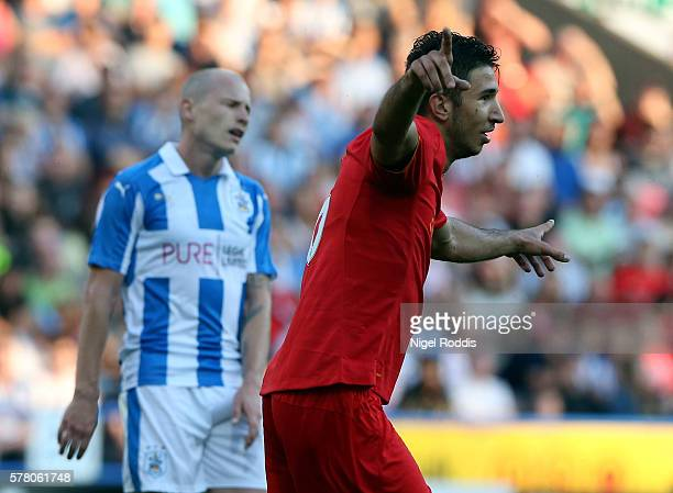 Marko Grujic of Liverpool celebrates scoring during the PreSeason Friendly match between Huddersfield Town and Liverpool at the Galpharm Stadium on...