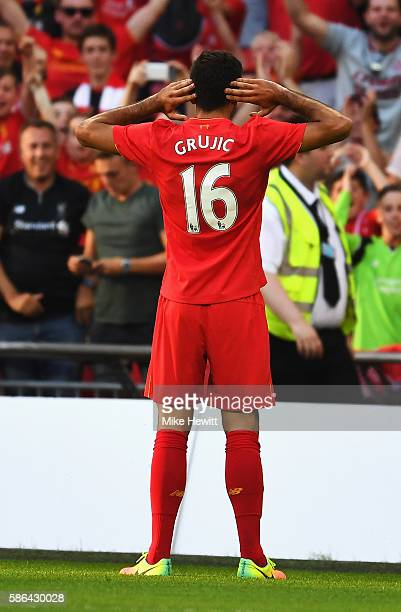 Marko Grujic of Liverpool celebrates scoring his team's fourth goal during the International Champions Cup match between Liverpool and Barcelona at...