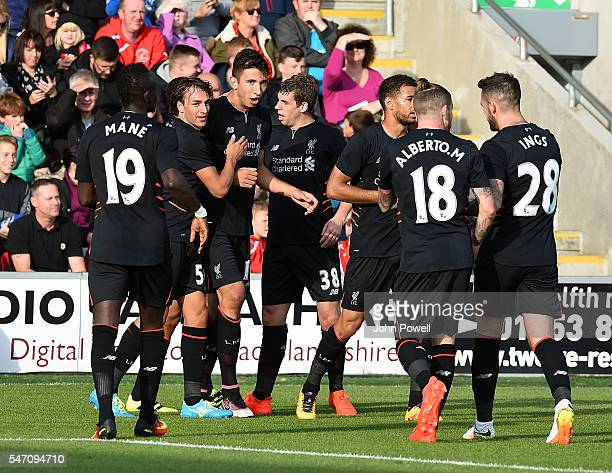 Marko Grujic of Liverpool celebrates with his team mates after scoring the opening goal during the PreSeason Friendly match bewteen Fleetwood Town...