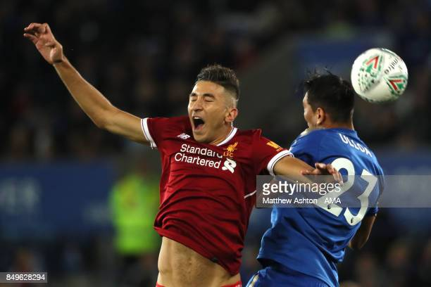 Marko Grujic of Liverpool competes with Leonardo Ulloa of Leicester City during the Carabao Cup third round match between Leicester City and...