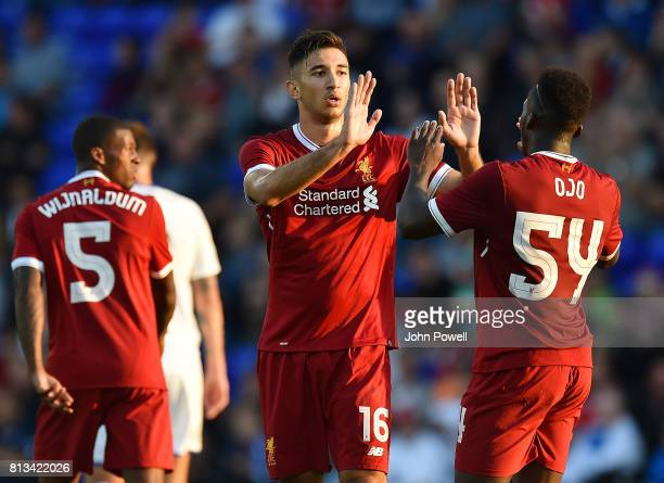 Marko Grujic of Liverpool scores the second during the pre season friendly between Tranmere Rovers and Liverpool at Prenton Park on July 12 2017 in...