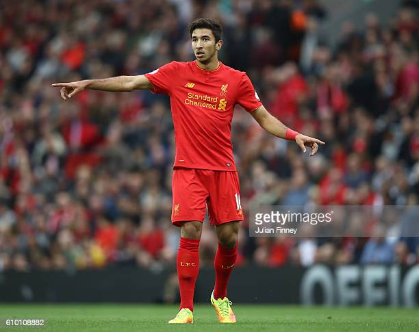 Marko Grujic of Liverpool signals during the Premier League match between Liverpool and Hull City at Anfield on September 24 2016 in Liverpool England