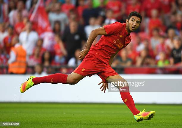 Marko Grujic of Liverpool watches his header hit the back of the net for his team's fourth goal during the International Champions Cup match between...