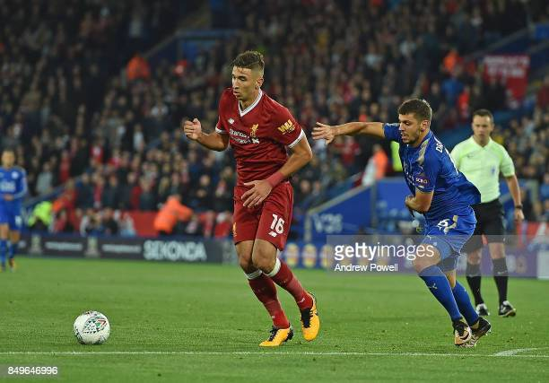 Marko Grujic of Liverpool with Aleksandar Dragovic of Leicester during the Carabao Cup third round match between Leicester City and Liverpool at The...