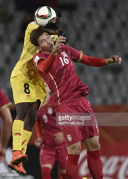 Marko Grujic of Serbia jumps for the ball with Diadie Samassekou of Mali during the FIFA Under20 World Cup football match between Serbia and Mali at...