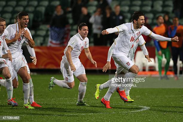 Marko Grujic of Serbia leads teammates as they celebrate their victory during a penalty shootout during the FIFA U20 World Cup quarterfinal match...