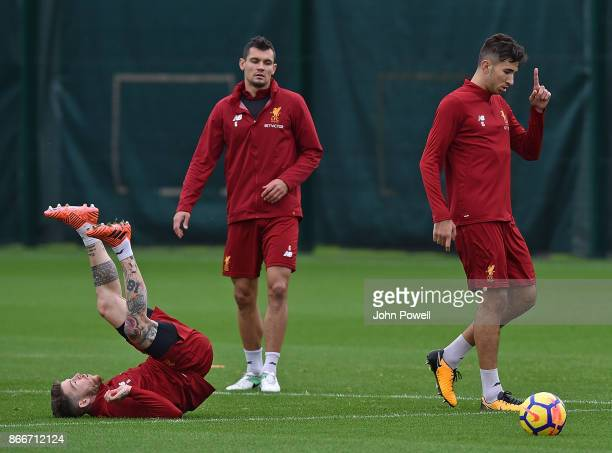 Marko Grujic with Alberto Moreno and Dejan Lovren of Liverpool during a training session at Melwood Training Ground on October 26 2017 in Liverpool...