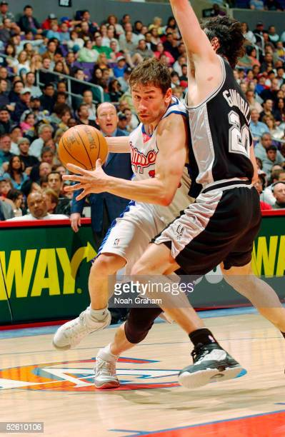 Marko Jaric of the Los Angeles Clippers drives to the hoop against Manu Ginobili of the San Antonio Spurs on April 9 2005 at the Staples Center in...