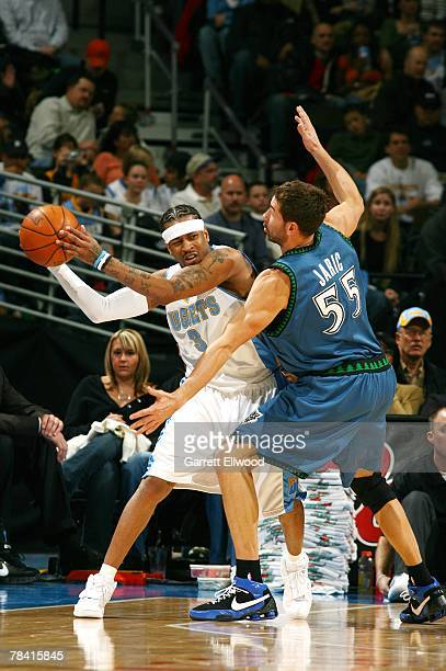 Marko Jaric of the Minnesota Timerwolves plays defense against Allen Iverson of the Denver Nuggets during the game on November 23 2007 at the Pepsi...