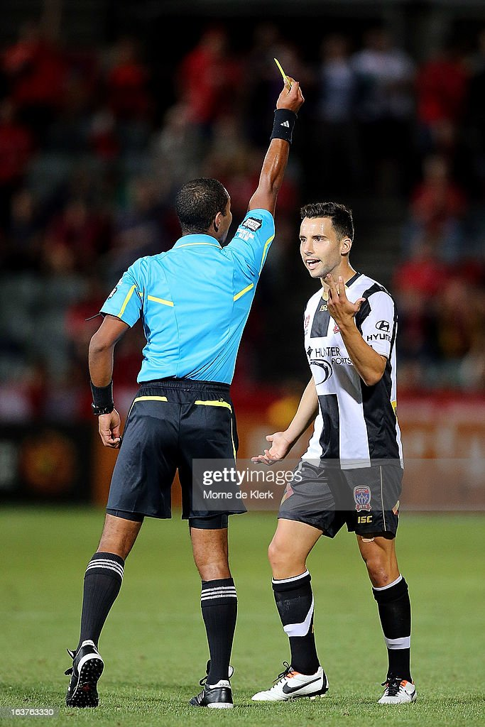 Marko Jesic of the Jets receives a yellow card during the round 25 A-League match between Adelaide United and the Newcastle Jets at Hindmarsh Stadium on March 15, 2013 in Adelaide, Australia.