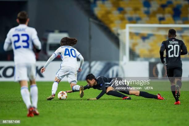 Marko Jevtovic of FK Partizan Belgrade tackles Mykola Shaparenko of FC Dynamo Kyiv during the UEFA Europa League group B match between FC Dynamo Kyiv...