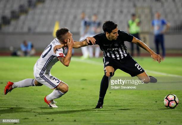 Marko Jevtovic of Partizan in action against Roland Szolnoki of Videoton during the UEFA Europa League Qualifying PlayOffs round first leg match...