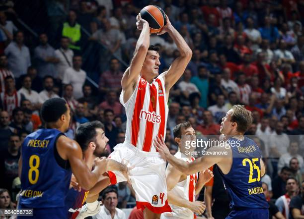 Marko Keselj of Crvena Zvezda in action against Petteri Koponen and Kevin Seraphin of Barcelona during the 2017/2018 Turkish Airlines EuroLeague...