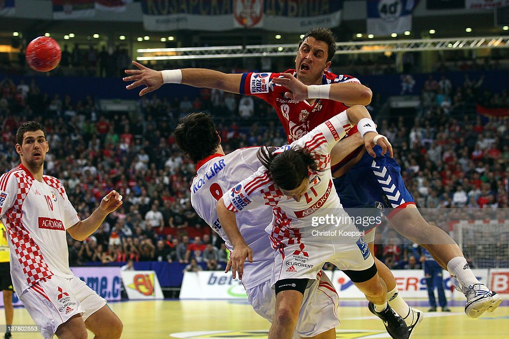 Marko Kopljar (C) and Ivan Cupic of Croatia (R) defend against Momir Ilic of Serbia (R) during the Men's European Handball Championship second semi final match between Serbia and Croatia at Beogradska Arena on January 27, 2012 in Belgrade, Serbia.
