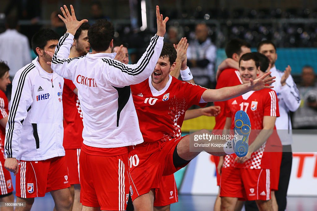 Marko Kopljar and Jakov Gojun of Croatia celebrate after the Men's Handball World Championship 2013 third place match between Slovenia and Croatia at Palau Sant Jordi on January 26, 2013 in Barcelona, Spain. The match between Slovenija and Croatia ended 26-31.