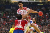 Marko Kopljar of Croatia shoots over Alem Toskic of Serbia during the Men's European Handball Championship second semi final match between Serbia and...