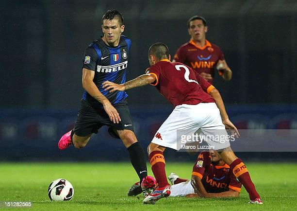 Marko Livaja of FC Internazionale Milano competes for the ball with Mattia Rosato of AS Roma during the Supercoppa Primavera match between FC...