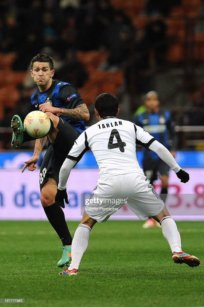 Marko Livaja (L) of FC Internazionale Milano in action against Tarlan Guliyev of Neftci PFK during the UEFA Europa League group H match between FC Internazionale Milano and Neftci PFK on December 6, 2012 in Milan, Italy.