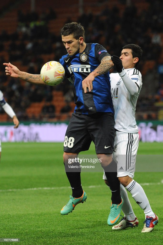 Marko Livaja (L) of FC Internazionale Milano is challenged by Tarlan Guliyev of Neftci PFK during the UEFA Europa League group H match between FC Internazionale Milano and Neftci PFK on December 6, 2012 in Milan, Italy.