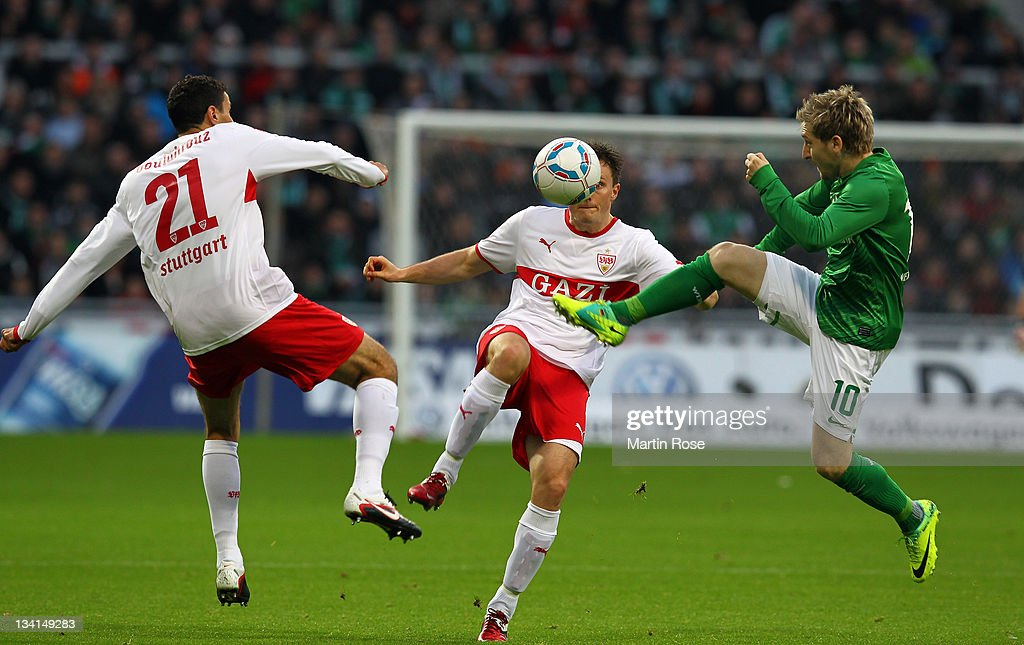<a gi-track='captionPersonalityLinkClicked' href=/galleries/search?phrase=Marko+Marin&family=editorial&specificpeople=650591 ng-click='$event.stopPropagation()'>Marko Marin</a> (R) of Bremen and <a gi-track='captionPersonalityLinkClicked' href=/galleries/search?phrase=William+Kvist&family=editorial&specificpeople=2465270 ng-click='$event.stopPropagation()'>William Kvist</a> (C) of Stuttgart battle for the ball during the Bundesliga match between Werder Bremen and VfB Stuttgart at Weser Stadium on November 27, 2011 in Bremen, Germany.