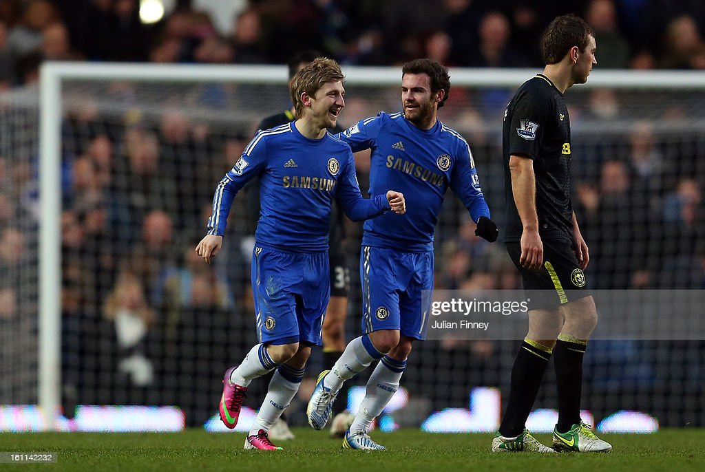 Marko Marin of Chelsea is congratulated by Juan Mata of Chelsea after he scored a goal during the Barclays Premier League match between Chelsea and Wigan Athletic at Stamford Bridge on February 9, 2013 in London, England.