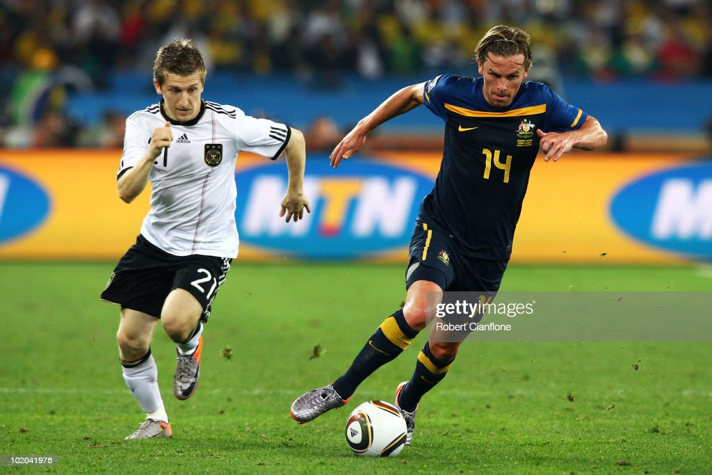 <a gi-track='captionPersonalityLinkClicked' href=/galleries/search?phrase=Marko+Marin&family=editorial&specificpeople=650591 ng-click='$event.stopPropagation()'>Marko Marin</a> of Germany pursues <a gi-track='captionPersonalityLinkClicked' href=/galleries/search?phrase=Brett+Holman&family=editorial&specificpeople=2224226 ng-click='$event.stopPropagation()'>Brett Holman</a> of Australia during the 2010 FIFA World Cup South Africa Group D match between Germany and Australia at Durban Stadium on June 13, 2010 in Durban, South Africa.