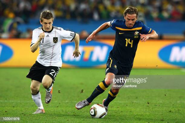 Marko Marin of Germany pursues Brett Holman of Australia during the 2010 FIFA World Cup South Africa Group D match between Germany and Australia at...