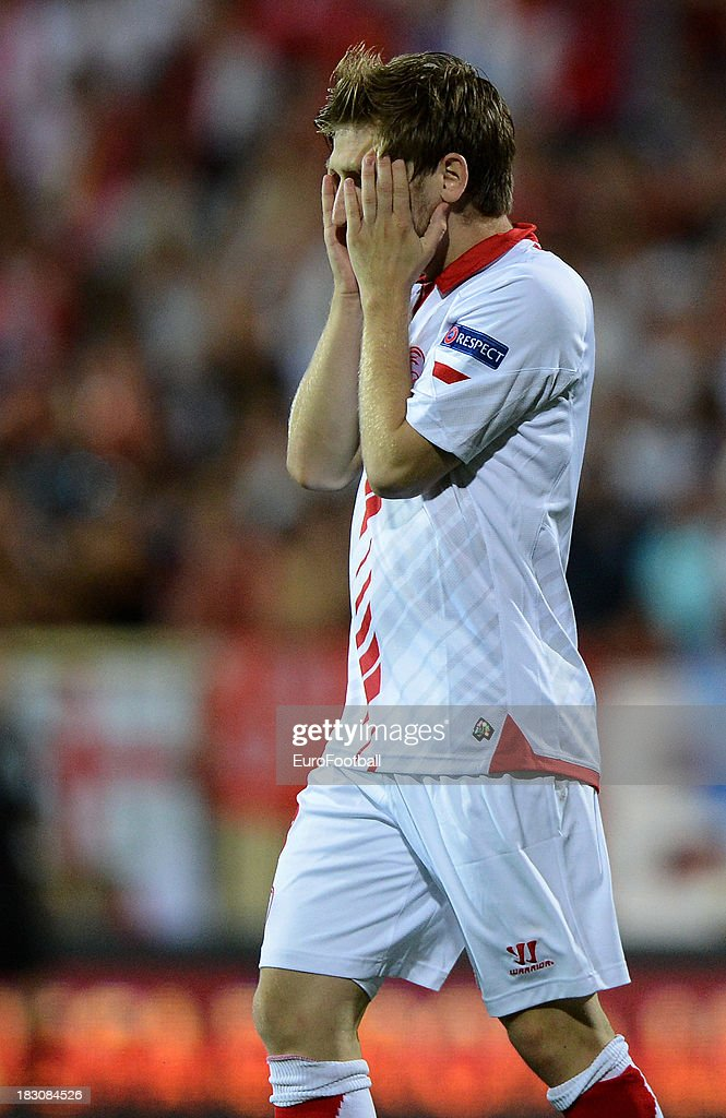 <a gi-track='captionPersonalityLinkClicked' href=/galleries/search?phrase=Marko+Marin&family=editorial&specificpeople=650591 ng-click='$event.stopPropagation()'>Marko Marin</a> of Sevilla FC in action during the UEFA Europa League group stage match between Estoril Praia and Sevilla FC held on September 19, 2013 at the Antonio Coimbra Da Mota Stadium, in Estoril, Portugal.