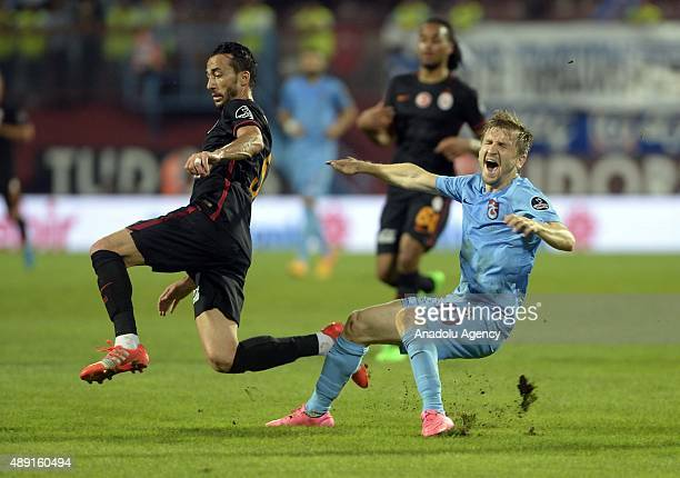 Marko Marin of Trabzonspor is in action against Bilal Kisa of Galatasaray during a Turkish Spor Toto Super League soccer match between Trabzonspor...