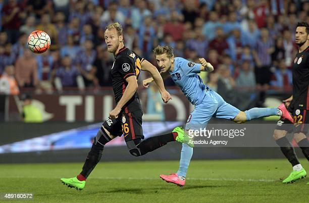 Marko Marin of Trabzonspor is in action against Semih Kaya of Galatasaray during a Turkish Spor Toto Super League soccer match between Trabzonspor...