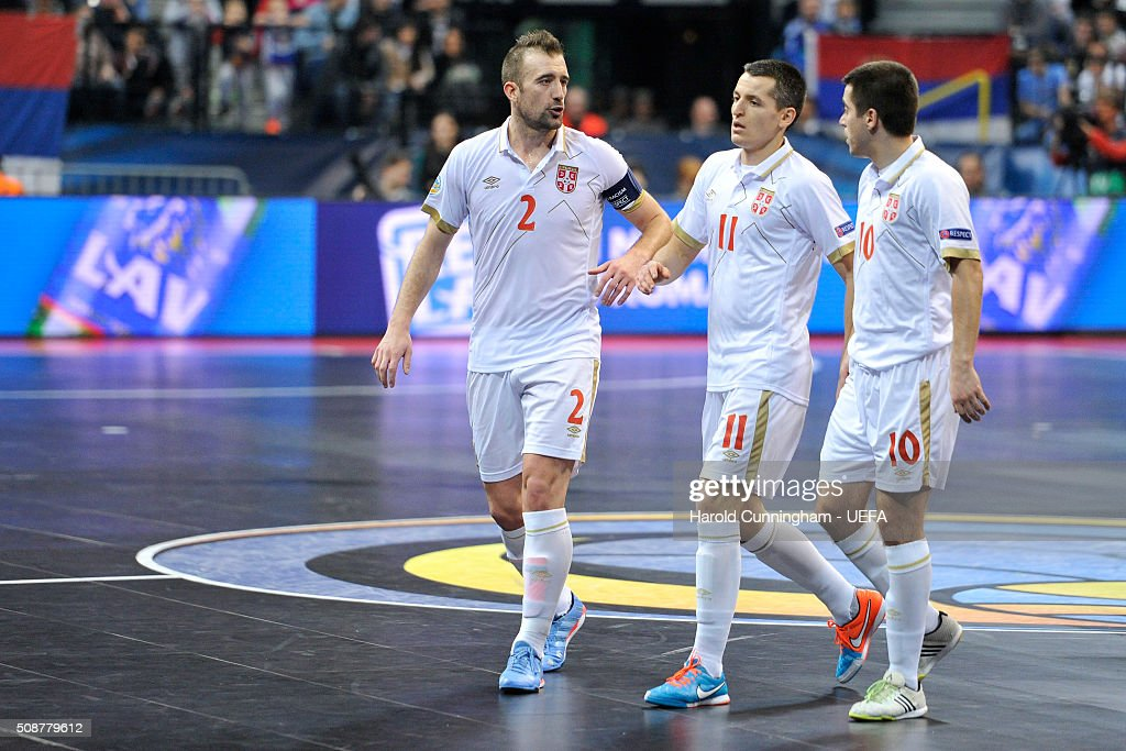 Marko Peric, Milos Simic and Mladen Kocic of Serbia speak during the UEFA Futsal EURO 2016 match between Portugal and Serbia at Arena Belgrade on February 6, 2016 in Belgrade, Serbia.