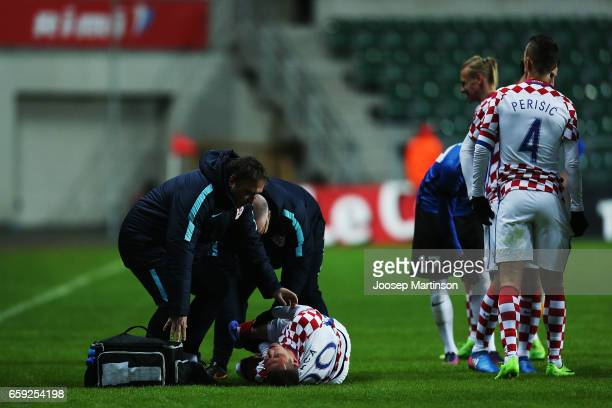 Marko Pjaca of Croatia lays on the field injured during international friendly between Estonia and Croatia at A le Coq Arena on March 28 2017 in...