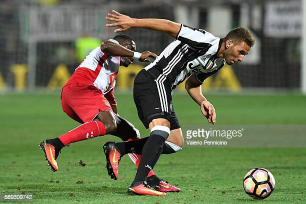 Marko Pjaca of FC Juventus is challenged by Pape Diop of Espanyol during the PreSeason Friendly match between FC Juventus and Espanyol at Alberto...