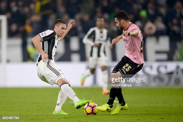 Marko Pjaca of Juventus FC and Bruno Henrique of US Citta di Palermo compete for the ball during the Serie A football match between Juventus FC and...