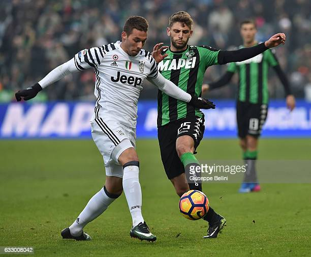Marko Pjaca of Juventus FC and Domenico Berardi of US Sassuolo in action during the Serie A match between US Sassuolo and Juventus FC at Mapei...
