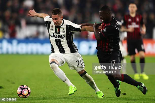 Marko Pjaca of Juventus FC competes with Cristian Zapata of AC Milan during the Serie A match between Juventus FC and AC Milan at Juventus Stadium on...