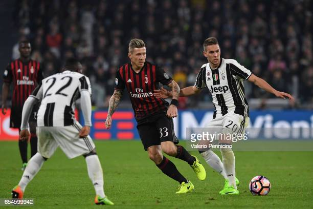 Marko Pjaca of Juventus FC in action against Juraj Kucka of AC Milan during the Serie A match between Juventus FC and AC Milan at Juventus Stadium on...