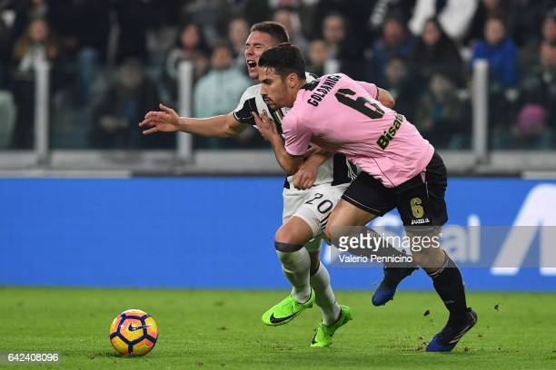 Marko Pjaca of Juventus FC is tackled by Edoardo Goldaniga of US Citta di Palermo during the Serie A match between Juventus FC and US Citta di...
