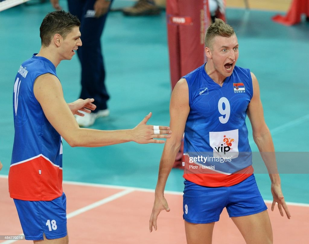 Marko Podrascanin and Nikola Jovovic of Serbia celebrate after winning a point during the FIVB World Championships match between Venezuela and Serbia...
