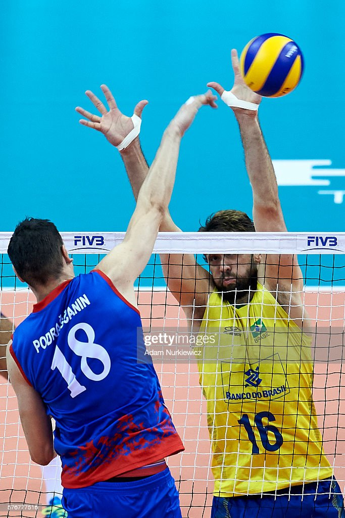 Marko Podrascanin from Serbia spikes against Lucas Saatkamp from Brazil while the FIVB World League volleyball Final match between Serbia and Brazil...
