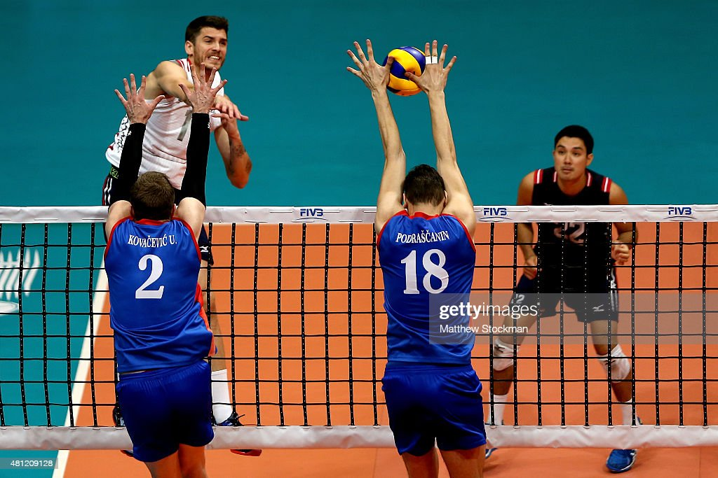 Marko Podrascanin of Serbia blocks an attack by Matthew Anderson of the United States during the FIVB World League Group 1 Finals semifinal match...