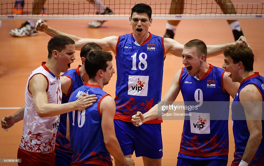 Marko Podrascanin of Serbia celebrate with the team mates Nikola Jovovic and Milos Nikic during the match between Brasil and Serbia on the FIVB World...