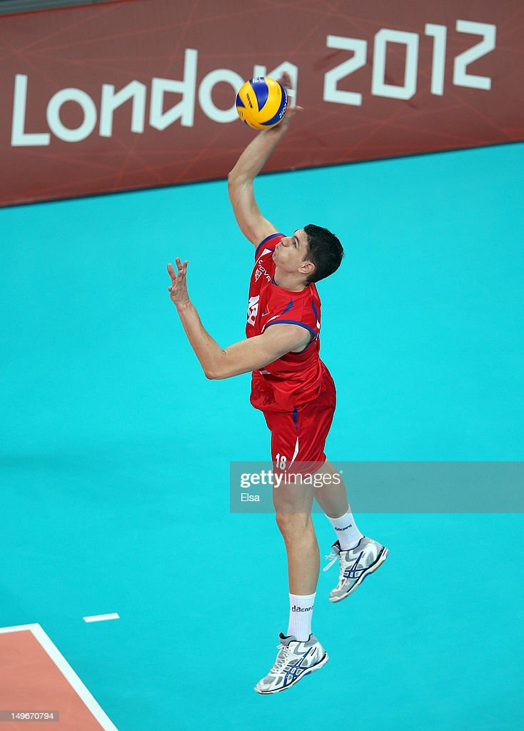Marko Podrascanin of Serbia serves the ball in the first set against Germany during Men's Volleyball on Day 6 of the London 2012 Olympic Games at...