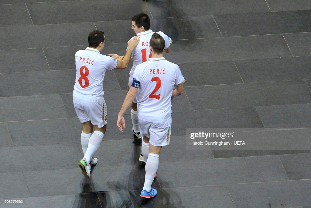 Marko Prsic, Mladen Kocic and Marko Peric of Serbia celebrate a goal during the UEFA Futsal EURO 2016 match between Portugal and Serbia at Arena Belgrade on February 6, 2016 in Belgrade, Serbia.