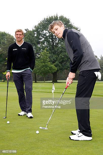 Marko Rehmer and Tim Bendzko attend the 'Camp David Eagles Hauptstadt Golf Cup' on May 19 2014 in Berlin Germany