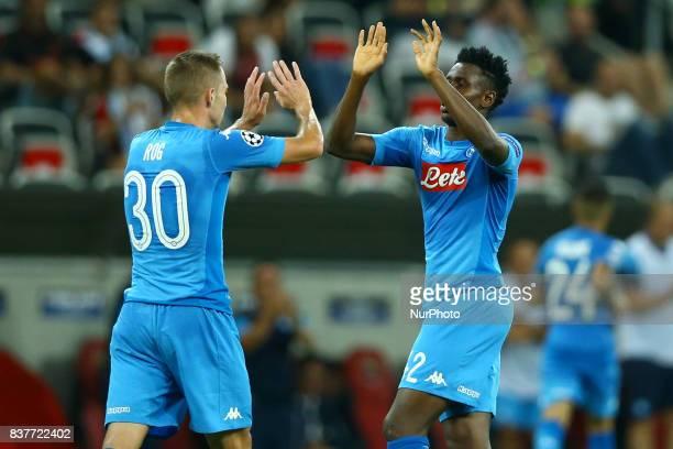 Marko Rog of Napoli and Amadou Diawara of Napoli celebrate during the UEFA Champions League Qualifying PlayOffs round second leg match between OGC...