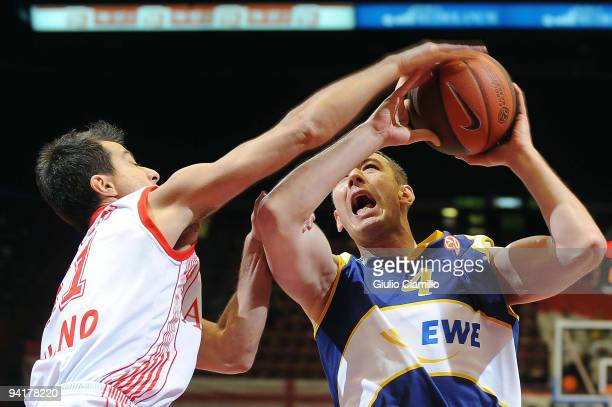 Marko Scekic #4 of EWE Baskets Oldenburg puts up a shot competing with Massimo Bulleri #11 of Armani Jeans Milano in action during the Euroleague...