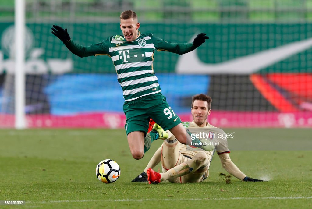 Marko Scepovic (R) of Videoton FC fouls Roland Varga #97 of Ferencvarosi TC during the Hungarian OTP Bank Liga match between Ferencvarosi TC and Videoton FC at Groupama Arena on December 2, 2017 in Budapest, Hungary.