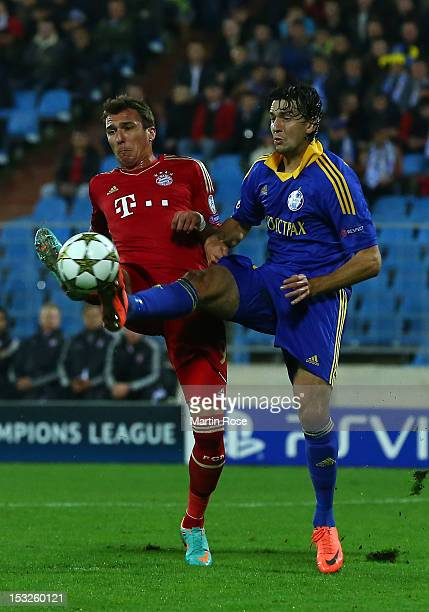Marko Simic of Borisov and Mario Mandzukic of Muenchen battle for the ball the during UEFA Champions League group F match between FC Bayern Muenchen...